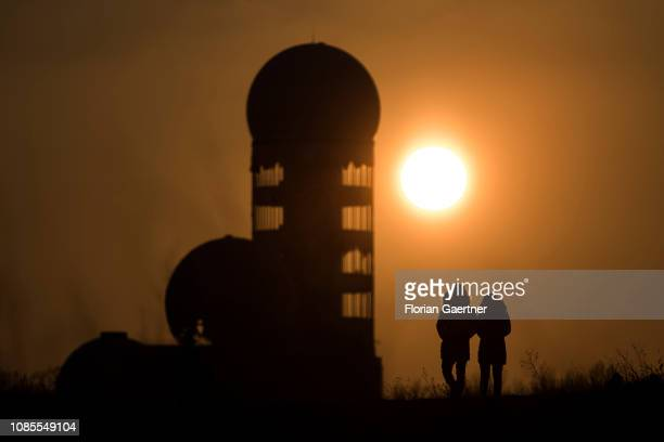 A couple is pictured in front of the former US listening station on 'Teufelsberg' at sunset on January 20 2019 in Berlin Germany