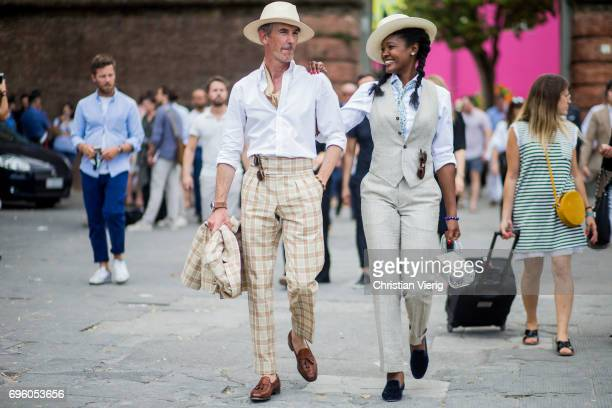 A couple is seen during Pitti Immagine Uomo 92 at Fortezza Da Basso on June 14 2017 in Florence Italy