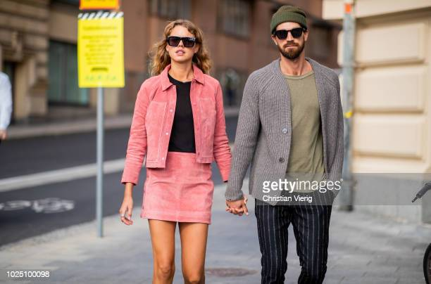 A couple is seen during Stockholm Runway SS19 on August 29 2018 in Stockholm Sweden