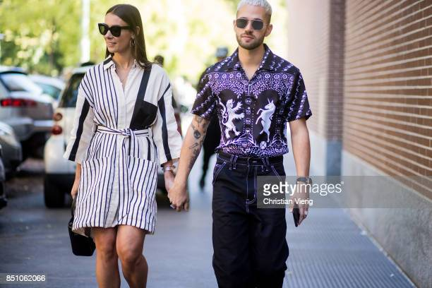 A couple is seen outside Fendi during Milan Fashion Week Spring/Summer 2018 on September 21 2017 in Milan Italy