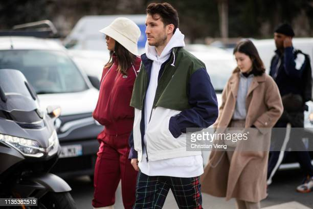 A couple is seen outside Lacoste during Paris Fashion Week Womenswear Fall/Winter 2019/2020 on March 05 2019 in Paris France