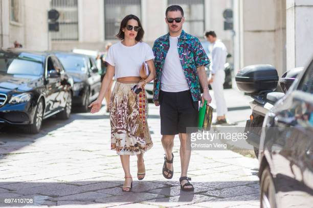 A couple is seen outside Salvatore Ferragamo during Milan Men's Fashion Week Spring/Summer 2018 on June 18 2017 in Milan Italy
