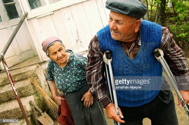 Couple is seen outside their house in the village of Marchalachen April 26, 2004 in Nagorno-Karabakh, Azerbaijan. The man is a WWII veteran who was...