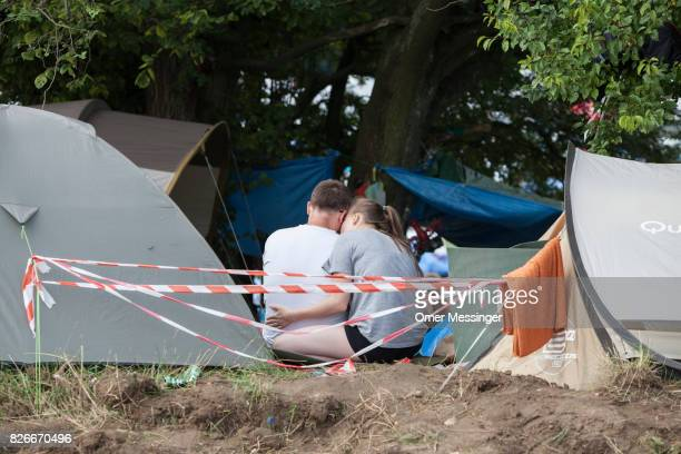 A couple is seen together in their camp site at the 2017 Woodstock Festival Poland on August 4 2017 in Kostrzyn Poland The threeday rock music...