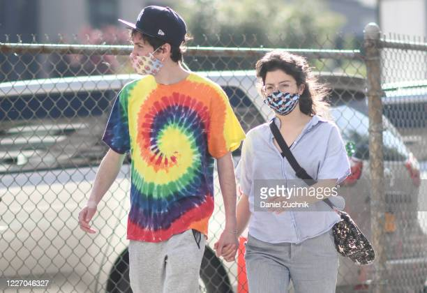 Couple is seen wearing a Larry David and a Judge Judy protective mask during the coronavirus pandemic on May 25, 2020 in Brooklyn, New York.