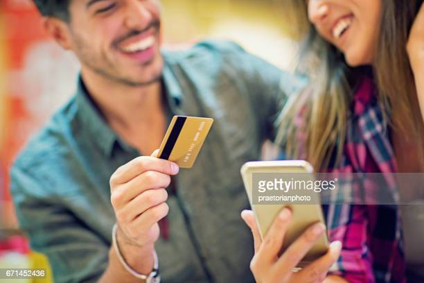 Couple is shopping online in the Mall