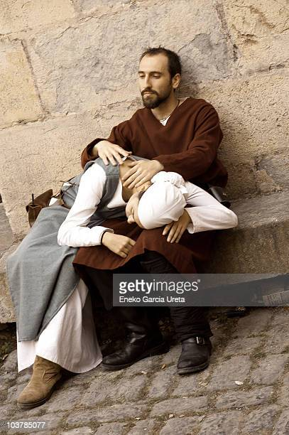 Couple is taking a break in the medieval market in town of Artziniega in the Basque Country.