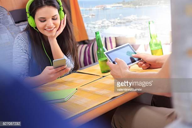 Couple istening music in caravan
