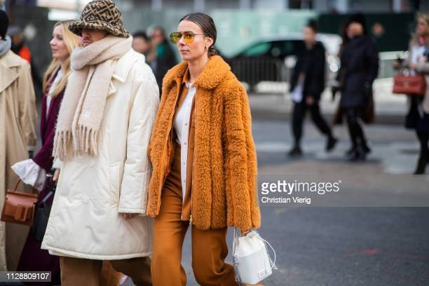 Couple JeanSebastian Rocques and Alice Barbier is seen wearing brown teddy coat outside Tory Burch during New York Fashion Week Autumn Winter 2019 on...