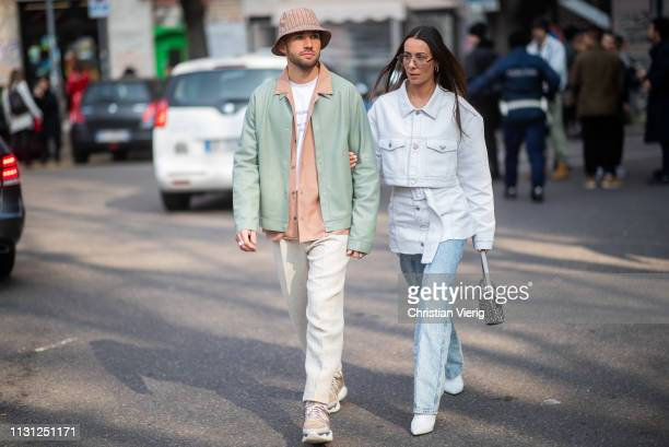 Couple JeanSebastien Rocques and Alice Barbier is seen outside Armani on Day 2 Milan Fashion Week Autumn/Winter 2019/20 on February 21 2019 in Milan...