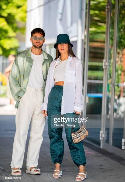 Couple Jean-Sebastien Roques and Alice Barbier wearing bucket hat, green pants is seen outside Freya Dalsjø during Copenhagen Fashion Week...