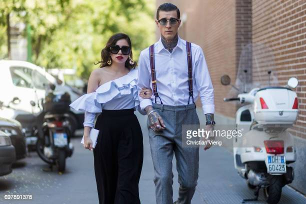 Couple Jimmy Q wearing grey pants suspenders white button shirt and Jet Luna wearing an off shoulder top black pants is seen outside Fendi during...