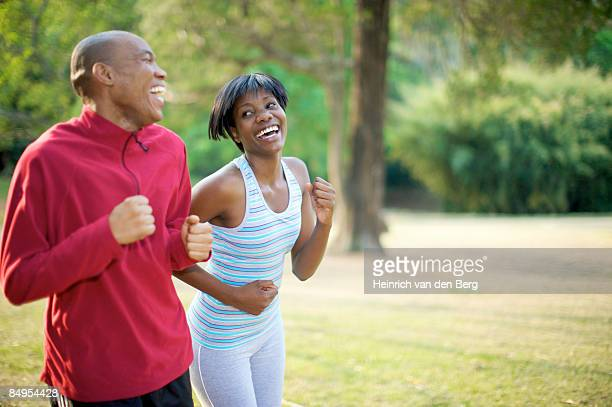 couple jogging in a park. pietermaritzburg, kwazulu-natal province, south africa - pietermaritzburg stock pictures, royalty-free photos & images