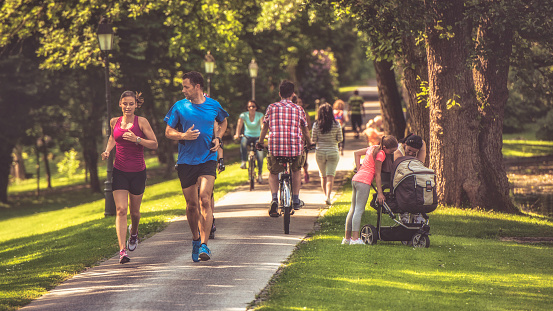 Couple jogging in the park 1086089532