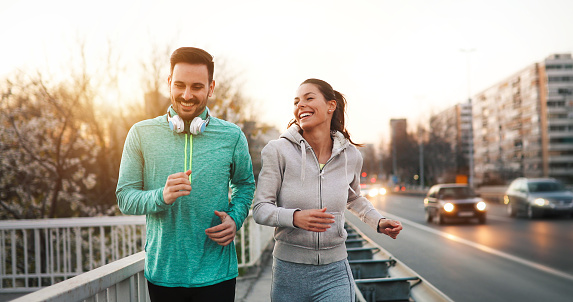 Couple jogging outdoors 888221342