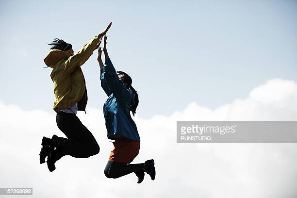 couple jumping for a high five