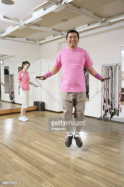 couple jumping rope - metabolic syndrome stock pictures, royalty-free photos & images