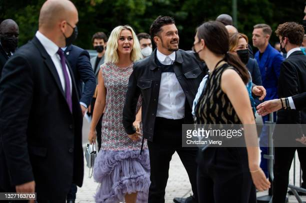 Couple Katy Perry is seen wearing dress and Orlando Bloom outside Louis Vuitton Parfum Hosts Dinner at Fondation Louis Vuitton on July 05, 2021 in...