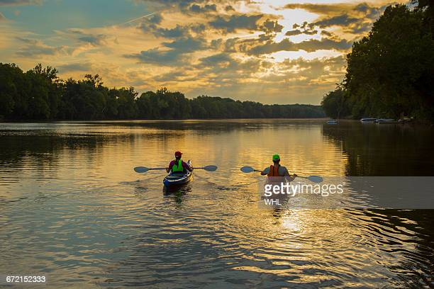 couple kayaking in river at sunset - richmond virginia stock pictures, royalty-free photos & images