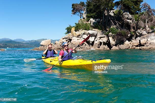 A couple kayaking on the Abel Tasman