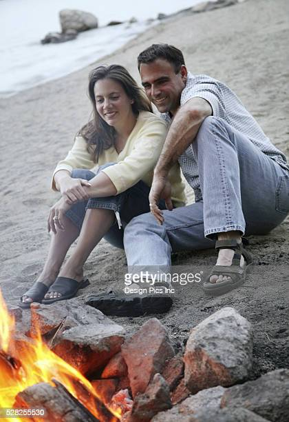 couple keep warm by campfire - hot women pics stock pictures, royalty-free photos & images