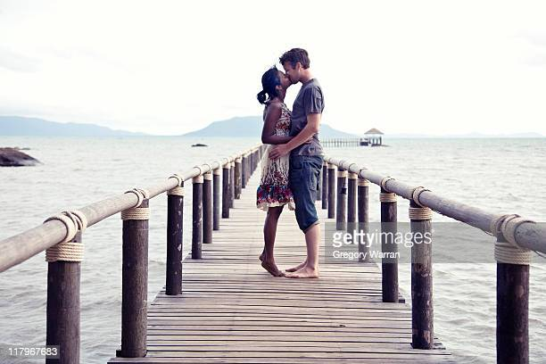 couple kiss and standing on jetty - indian couples stock pictures, royalty-free photos & images
