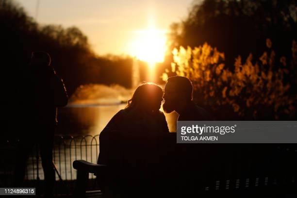 A couple kiss as the sun sets in St James's Park on Valentines Day on February 14 2019