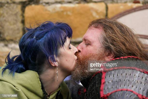 A couple kiss as they join other Viking reenactors to march through York during a living history display as part of the 36th York Viking Festival on...