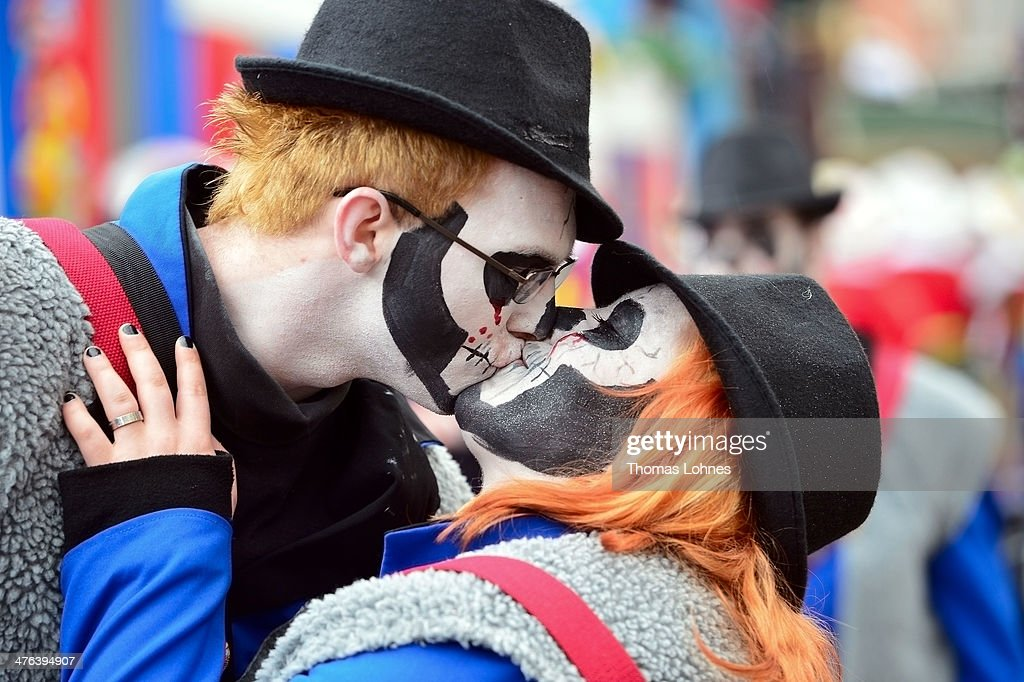 A couple kiss at the Monday carnival parade on March 3, 2014 in Mainz, Germany. Rose Monday is the highpoint of the annual carnival season in the region between Mainz, Cologne and Dusseldorf, where the carnival has been an annual tradition since 1823 and celebrates free-spirited merrymaking before the beginning of Lent.