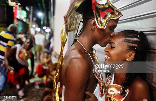 A couple kiss before performing on the first day of Carnival celebrations on February 16 2012 in Salvador Brazil Carnival is the grandest holiday in...