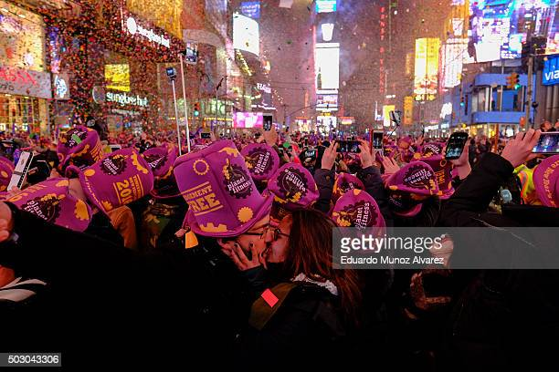 A couple kiss during celebrations at Times Square on January 1 2016 in New York City At least 6000 police officers were deployed including rooftop...