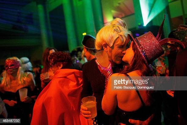 A couple kiss during the costume party at Circulo de Bellas Artes on February 15 2015 in Madrid Spain The carnival which is believed to come from...