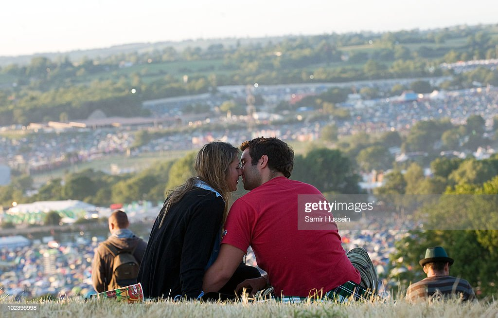 A couple kiss during the Glastonbury Festival on June 24, 2010 in Glastonbury, England. Glastonbury has become Europe's largest music festival and is celebrating its 40th anniversary.