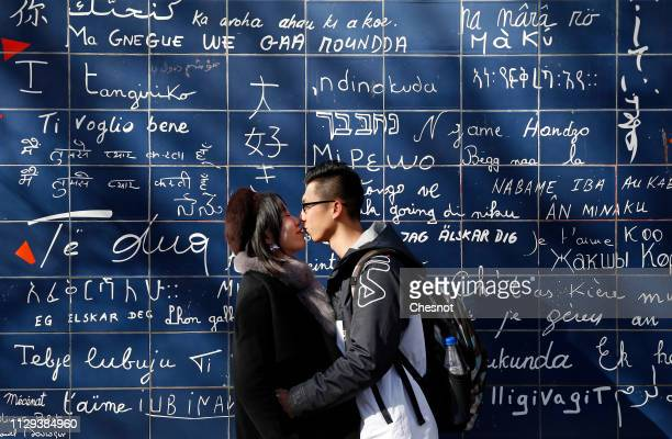 A couple kiss in front of «The wall ofI love you» on the eve of the Valentine's Day on February 13 2019 in Paris France 'The Wall of I Love You'...