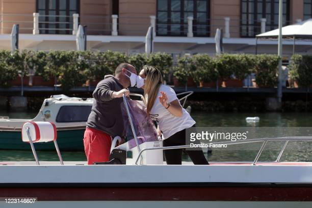 Couple kiss in their boat, after the decree of the president of the Puglia region Michele Emiliano, which allows people to go out to sea on Apr 30,...