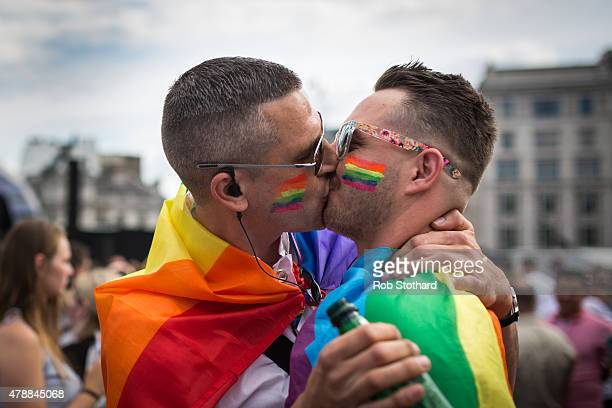 A couple kiss in Trafalgar Square after the annual Pride in London Parade on June 27 2015 in London England Pride in London is one of the world's...