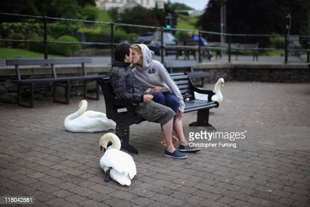 Couple kiss on bench at the side of Lake Windermere on June 1, 2011 in Windermere, United Kingdom. The English Lake District is on the shortlist of...