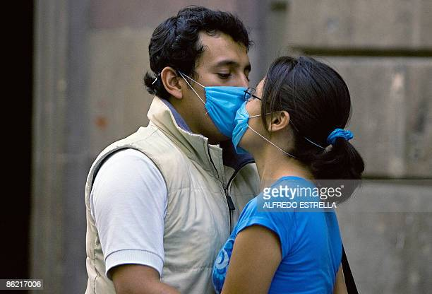 A couple kisses at the Historic Center in Mexico City on April 25 2009 An outbreak of deadly swine flu in Mexico and the United States has raised the...