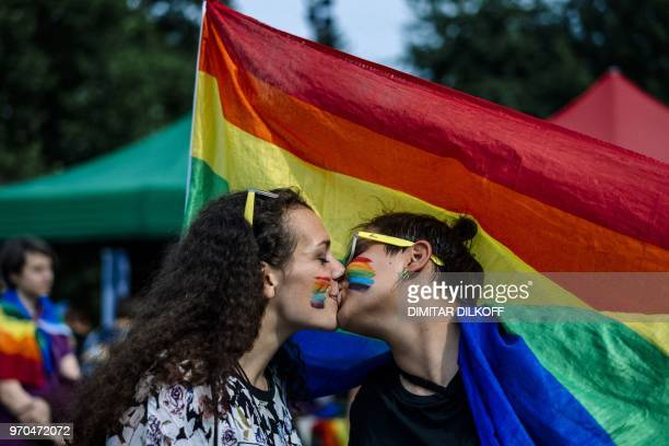 A couple kisses during the 11th Gay Pride Parade in downtown Sofia on June 9 as gays lesbians and transsexuals march through Bulgarian capital to...