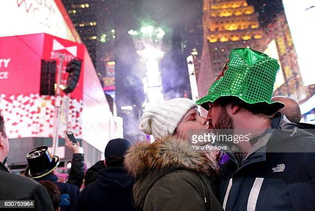 A couple kisses in celebration of New Year's eve in Times Square in New York City just after midnight on January 01 2017