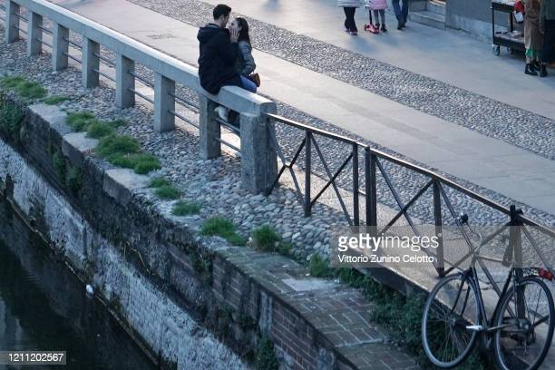 """Couple kisses in Naviglio Grande on March 08, 2020 in Milan, Italy. Prime Minister Giuseppe Conte announced overnight a """"national emergency"""" due to..."""