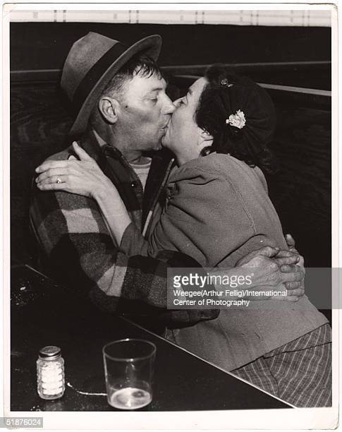 A couple kisses in the booth of a cafe or pub New York New York early 1950s Photo by Weegee/International Center of Photography/Getty Images