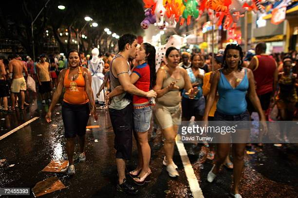 Couple kisses in the rain during Carnival on February 8, 2005 in Salvador, Brazil. Centuries of slave trade with Central and West Africa has left 40...