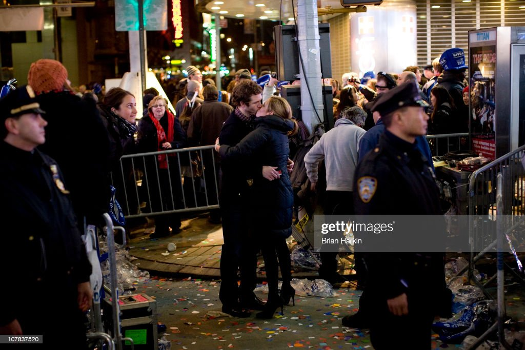 A couple kisses in Times Square as revelers begin to file out just after the annual ball drop January 01, 2011 in New York City. This year a 11,875-pound Waterford crystal ball descended a 141-foot tall flagpole to mark the beginning of 2011.