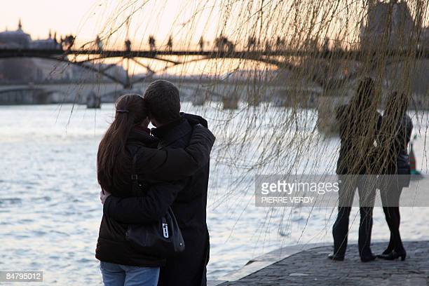 A couple kisses on Saint Valentine's Day on February 14 2009 near the river Seine in Paris In Paris the city of love thinkers pondered on what the...