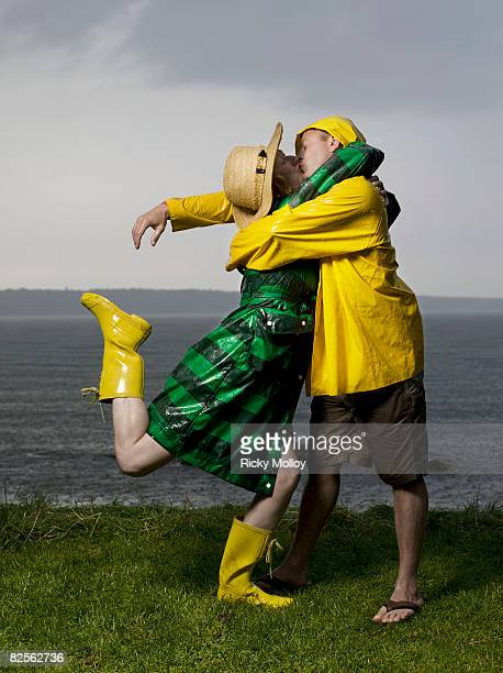 Couple kissing and hugging in the rain