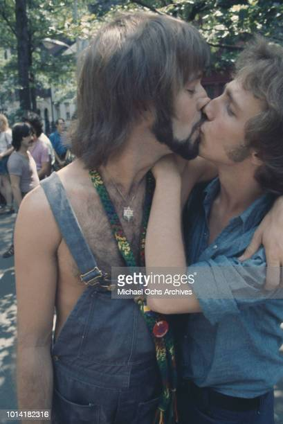 A couple kissing at an LGBT parade through New York City on Christopher Street Gay Liberation Day 1971