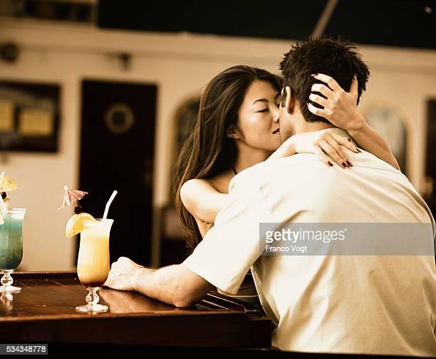 Couple Kissing at Bar