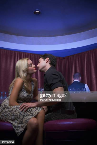 Couple kissing at nightclub