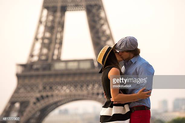 Couple kissing at the Eiffel Tower in Paris